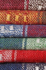 stack of colorful floor rugs
